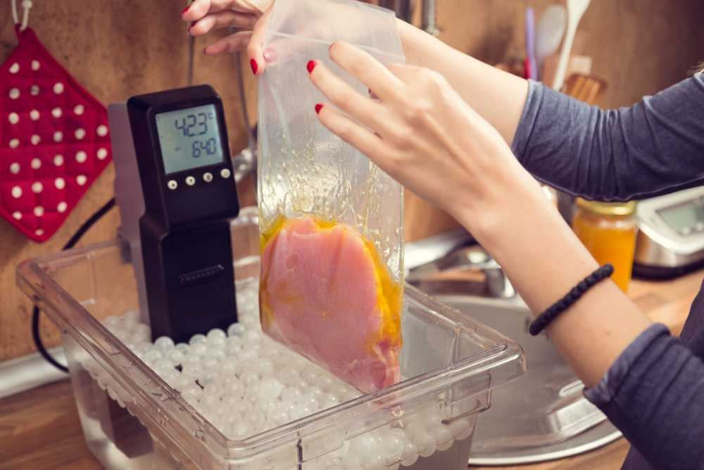 controlling water temperature for cooking with vacuum-sealed items